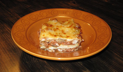 A slice of a lasagna with meat